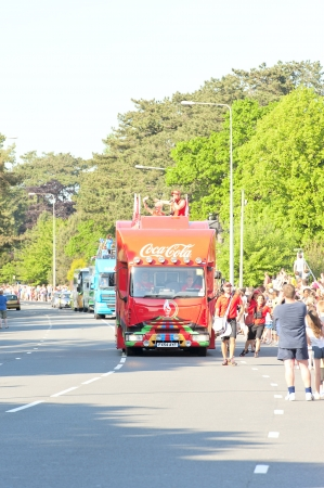 bearer: CARDIFF,WALESUK-MAY 25, 2012;The Coca-Cola sponsers of the 2012 olympics, support bus,travels with the bearer of the torch relay team bringing the torch into Cardiff on its tour of the UK Editorial