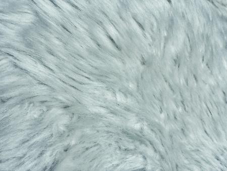 灰色の銀の毛皮のテクスチャ背景