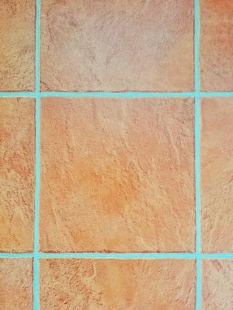 正方形のテラコッタ タイルのテクスチャ背景 写真素材