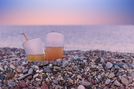 Juicy Cocktails on the Beach at Evening Sunset 写真素材