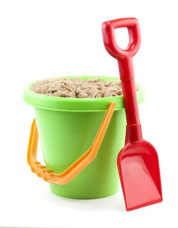 bucket and spade close up on white background photo