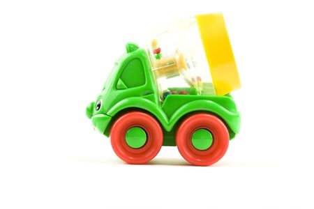 childs toy cement mixer on white background photo