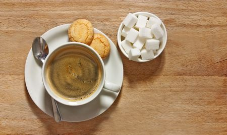 amaretto: rustic shot of filter coffee and biscuits on table