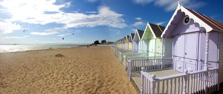 mersea beach huts and cloudscape in summer Stock Photo