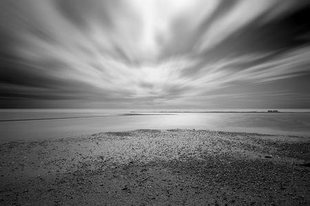 beach long exposure at mersea on sea in essex