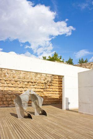 mediteranean: modern sculpture and decking area in summer sun