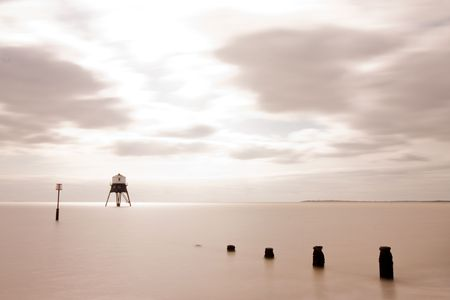 long exposure from the beach of a lighthouse at sea Stock Photo - 5566019