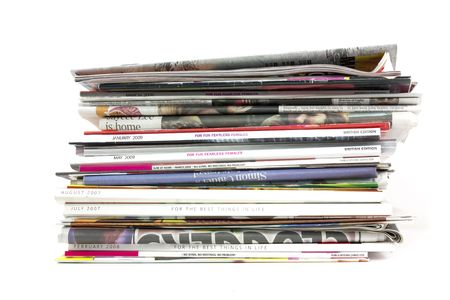 stack of newspapers and magazines on white background Stock Photo - 5565849