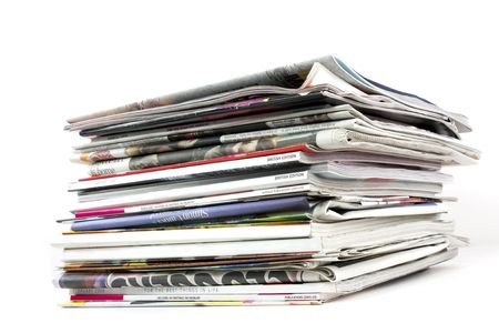 broadsheet: stack of newspapers and magazines on white background