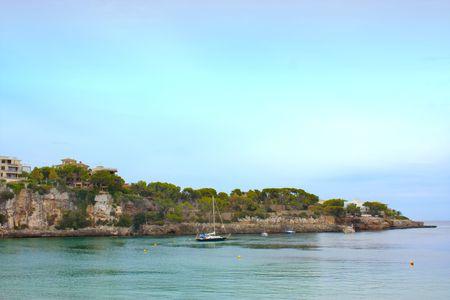 cristo: single boat moored in bay in porto cristo majorca