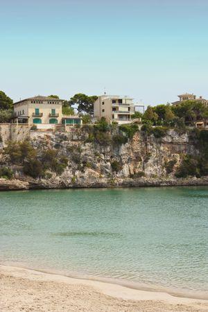 cristo: villas on the clifftop by porto cristo bay Stock Photo