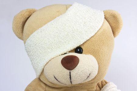 close up shot of cute bandagd bears head photo