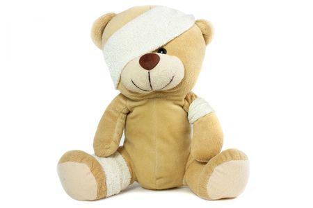 bandaged: teddy bear with bandaged head on white background