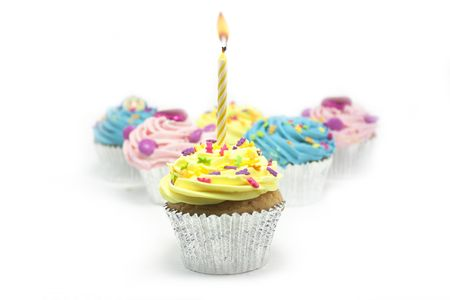 cupcake shot on a white background with one candle photo