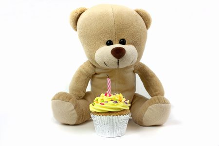lemon cake: teddy and cupcake wth 1 candle on white Stock Photo