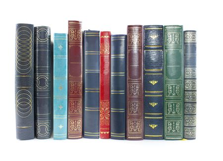 heap up: collection of old books lined up on white background
