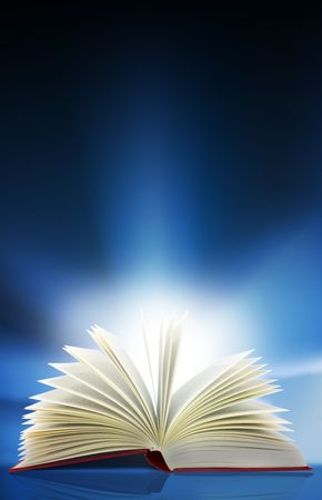 A beam of light shines out from an open book Stok Fotoğraf