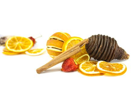 cocaine: still life of orange, cinnamon sticks and pine cones