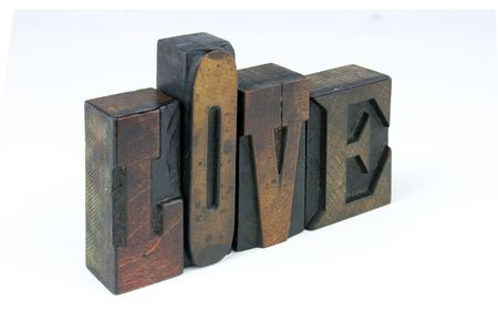 The word love in wooden letterpress printing block letters photo
