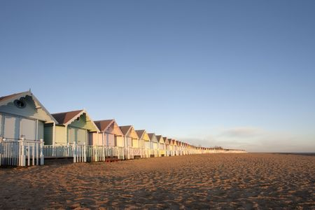 mersea: A line of pastel coloured beach huts at mersea in essex, uk