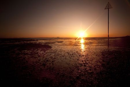 mersea: sunset also could be dawn at mersea beach in essex, uk Stock Photo