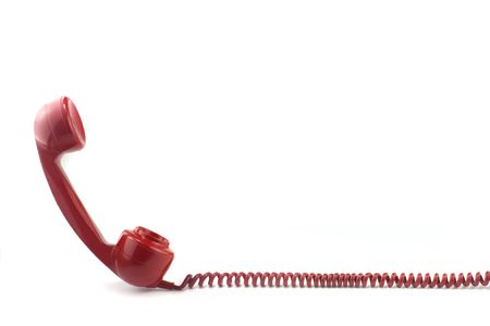 telephone cord: Old fashioned 1970s or 50s style red telephone Stock Photo