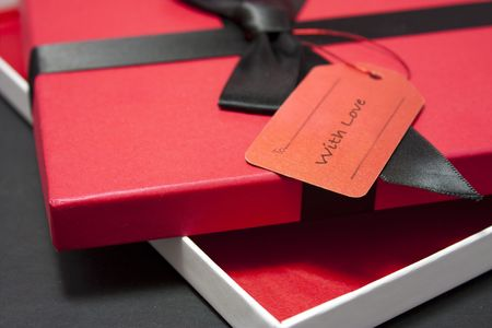 Gift or present with red box in a box with blank label photo