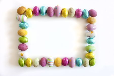 easter nest: easter eggs chocolate and painted border or background frame