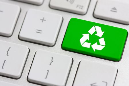 green recycle button on a modern silver keyboard photo