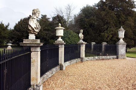 busts: old style statues or busts with iron railings at park