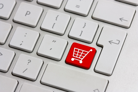 shopping cart: red retail shopping cart icon button on a keyboard
