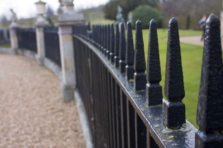 geschwungene linie: close up of park iron railings in a curved line shape