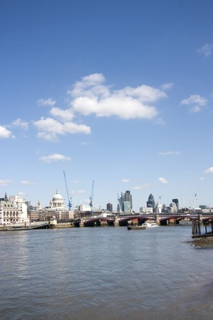 london city skyline at midday in spring with lots of cranes and construction photo
