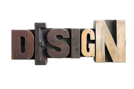 the word design formed from letterpress wooden blocks photo