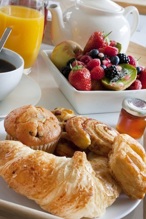 pastries, tea, coffee and juices for a special breakfast treat photo