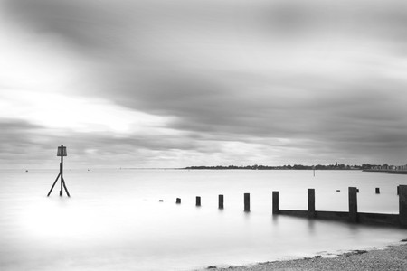 Brightlingsea, essex. Very long exposure to reveal misty sea and blurred clouds photo