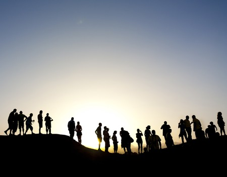 Group of people on top of a mountain in the sinai desert, northern egypt photo