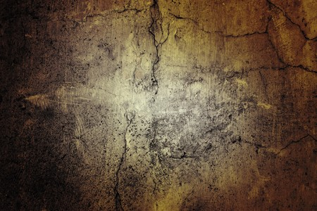 cracked cement: background texture of a very rough texture plastered wall