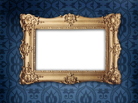 regency or victorian style gold frame hanging on decorative blue patterned wallpaper photo