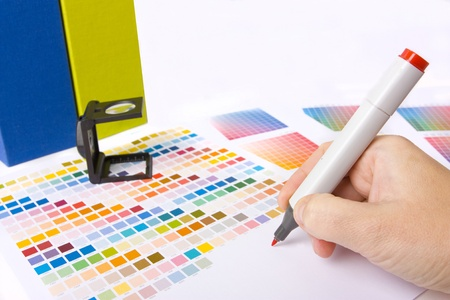 interior designer: graphic designer, printer or ilustrator with colour swatches