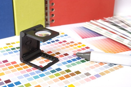 printing proof: Photographers lupe and colour swatches as used by a graphic designer or printer