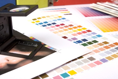 printing proof: typical graphic designers desk checking a printers proof