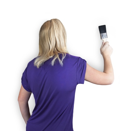 isolated shot of a woman painting a wall on white Stock Photo - 8466289