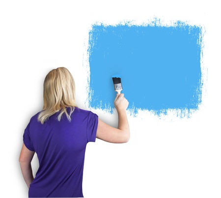 thirty���s: person painting a wall with blue paint Stock Photo