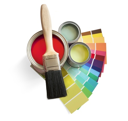 coloured swatches and paint pot and paintbrush on white background photo