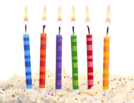 white candle: birthday cake with 6 coloured candles on a red background