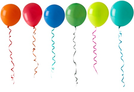 coloured party balloons and streamers floating on a white background Stock Photo