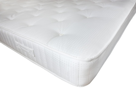 quilted: corner of a modern white mattress isolated on a white background