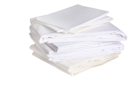 pile or stack of cotton white bed sheets Stock Photo - 9398735