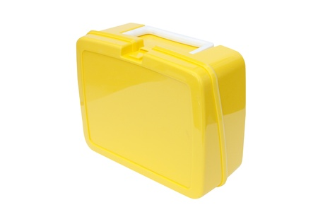 Childrens yellow plastic lunchbox on a white background